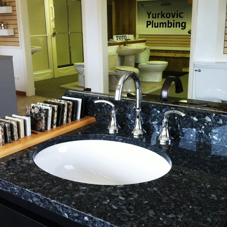 Yurkovic Plumbing offers Strasser Woodworks beautiful solid wood bathroom cabinetry with vanity tops in granite, marble, quartz or china.